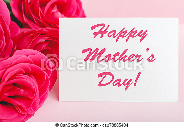 Happy Mothers Day text on gift card in flower bouquet of pink roses on pink background. Greeting card for Mom. Flower delivery, Congratulations card in flowers for women. Greeting card in roses - csp78885404