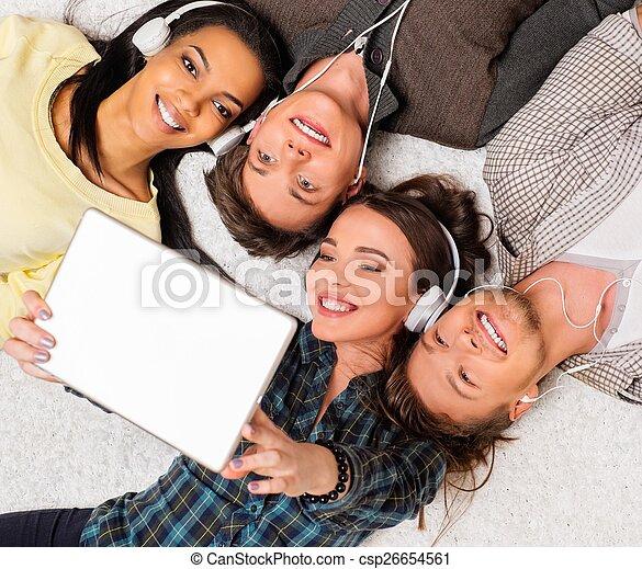 Happy multiracial friends taking selfie - csp26654561