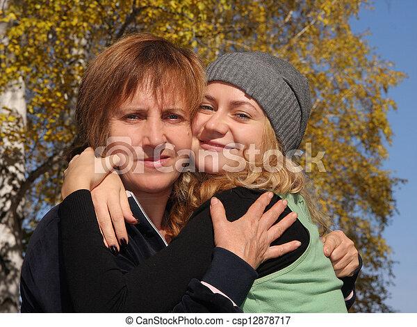 Happy mum with a daughter in autumn park 5 - csp12878717