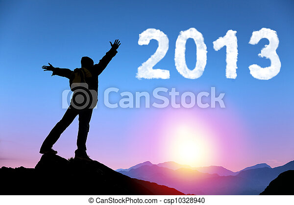 happy new year 2013. young man standing on the top of mountain watching the sunrise and cloud 2013 - csp10328940