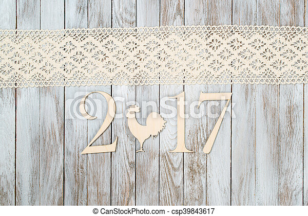 Happy New Year 2017 on wooden background. - csp39843617