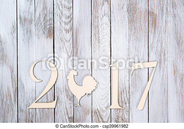 Happy New Year 2017 on wooden background. - csp39961982