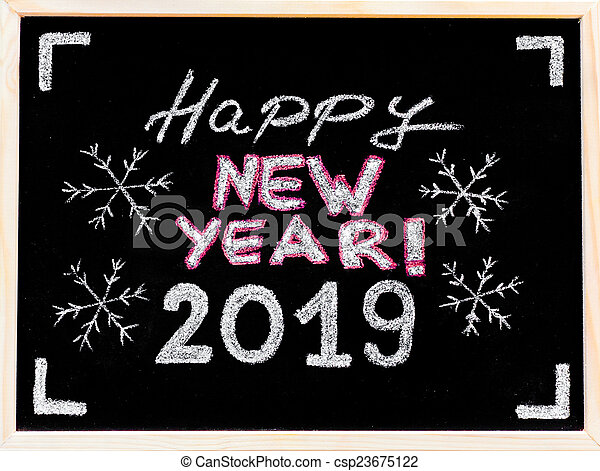 Happy new year 2019, hand writing with chalk on blackboard, vintage concept - csp23675122