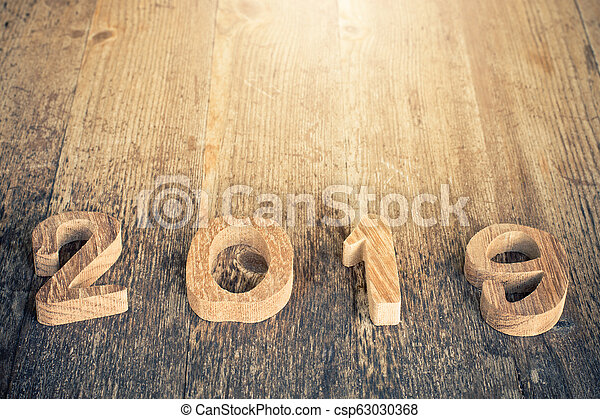 happy new year 2019 on wooden background. - csp63030368