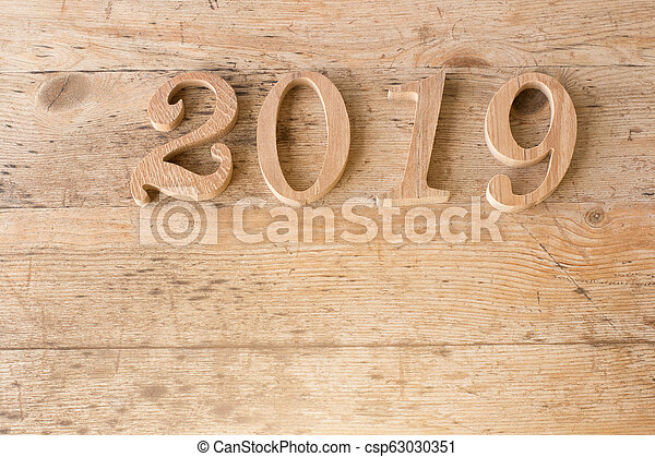 happy new year 2019 on wooden background. - csp63030351