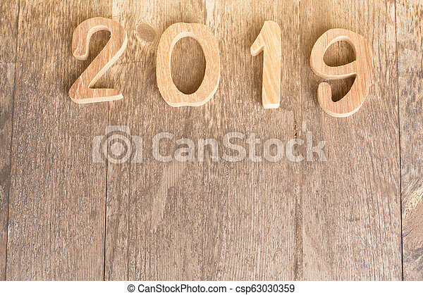 happy new year 2019 on wooden background. - csp63030359