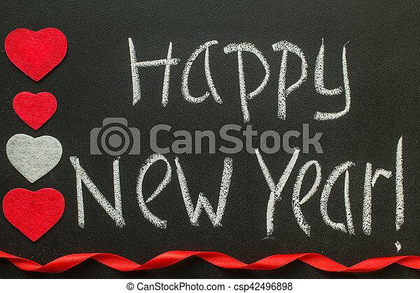 Happy new year handwriting on a blackboard happy new year message happy new year handwriting on a blackboard csp42496898 m4hsunfo