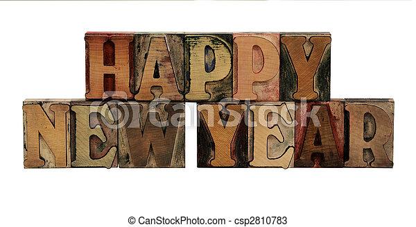 Happy New Year in letterpress wood letters - csp2810783