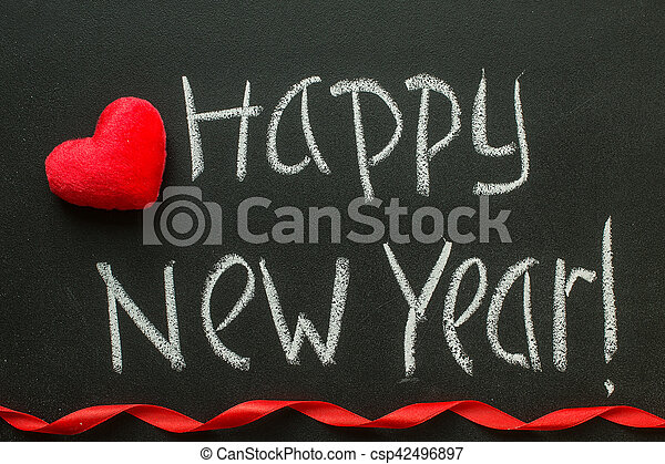 Happy New Year written on blackboard. - csp42496897