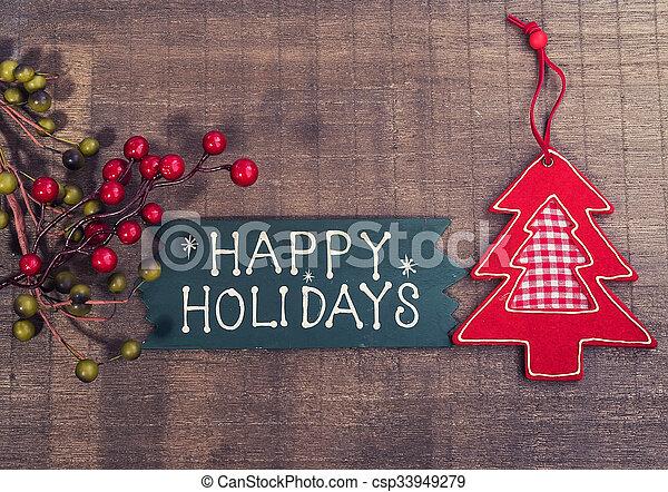 happy new year written on wooden background - csp33949279