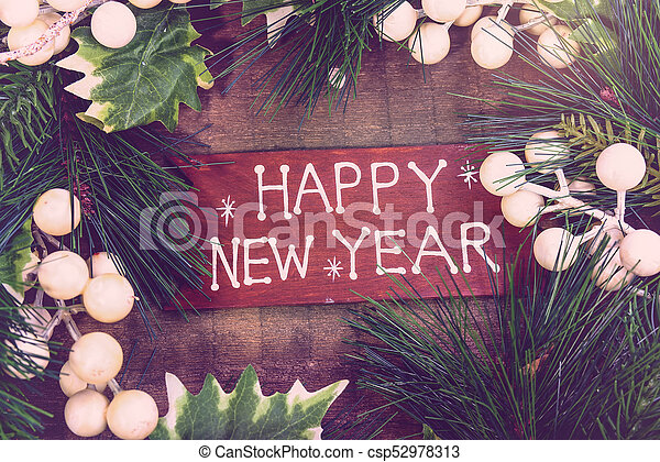 happy new year written on wooden background - csp52978313