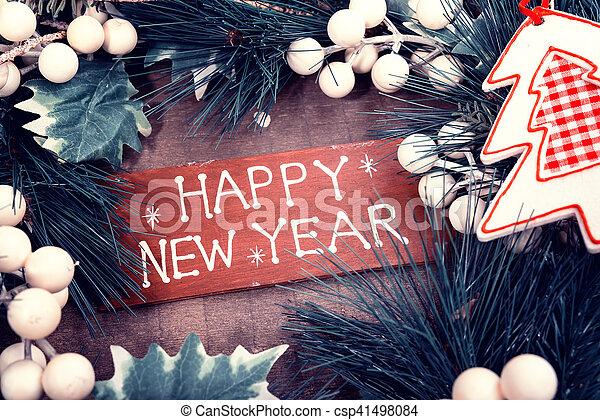 happy new year written on wooden background - csp41498084