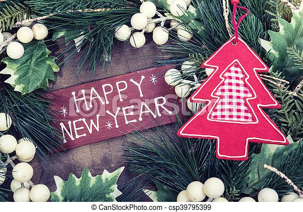 happy new year written on wooden background - csp39795399