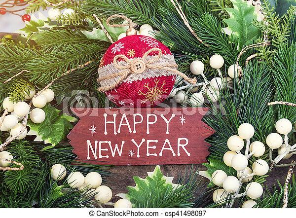 happy new year written on wooden background - csp41498097