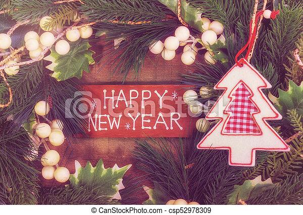 happy new year written on wooden background - csp52978309