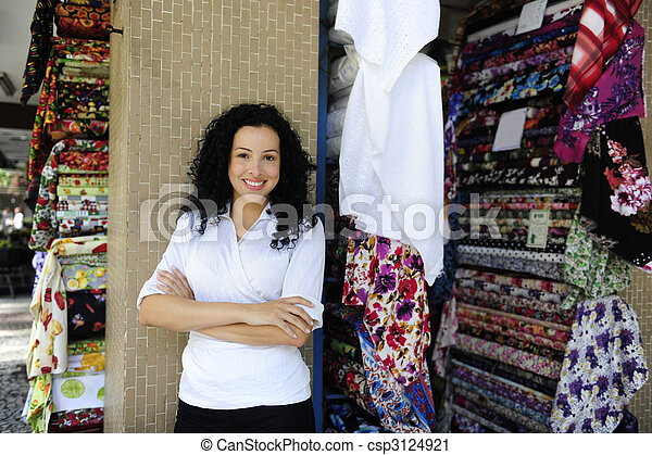 happy owner of a fabric store - csp3124921