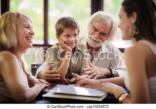 Happy parents and grandparents with boy in bar - csp10254870