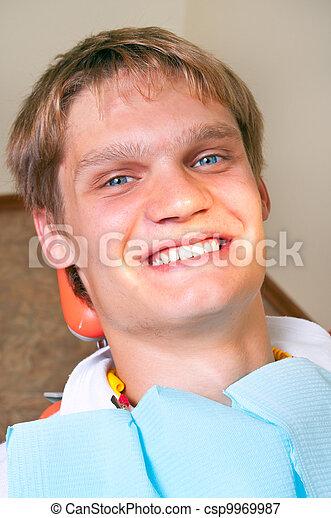 Happy patient in dental chair - csp9969987