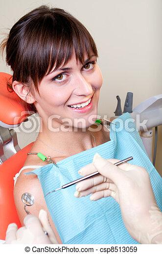 Happy patient in dental chair - csp8513059