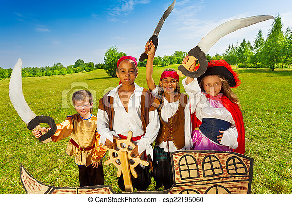 Happy pirate children and their captain with helm - csp22195060