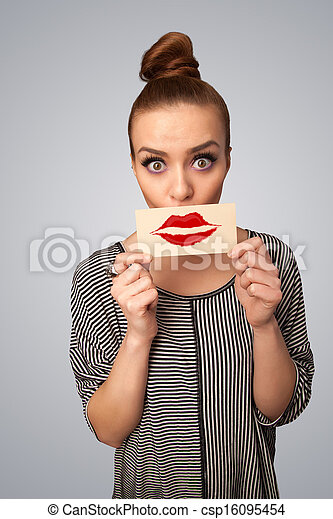 Happy pretty woman holding card with kiss lipstick mark - csp16095454