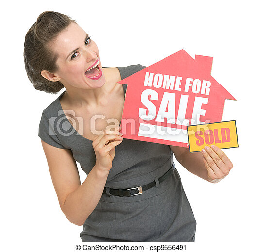 Happy real estate owner with home for sale sold sign - csp9556491