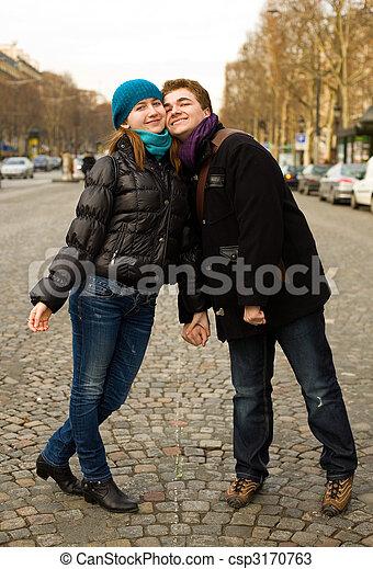 Happy romantic couple in Paris on the Champs Elysees - csp3170763