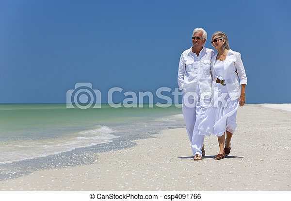 Happy Senior Couple Dancing Walking on A Tropical Beach - csp4091766