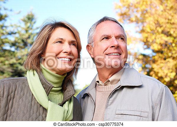 Happy senior couple in park. - csp30775374