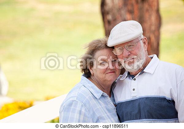 Happy Senior Couple in The Park - csp11896511
