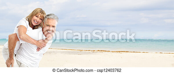Happy senior couple on the beach. - csp12403762