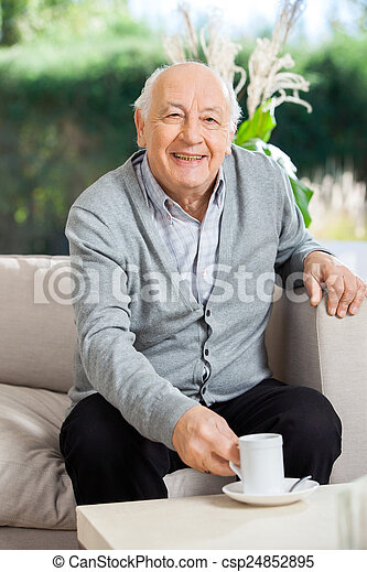 Happy Senior Man Having Coffee At Nursing Home Porch - csp24852895