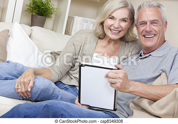 Happy Senior Man & Woman Couple Using Tablet Computer - csp8349308