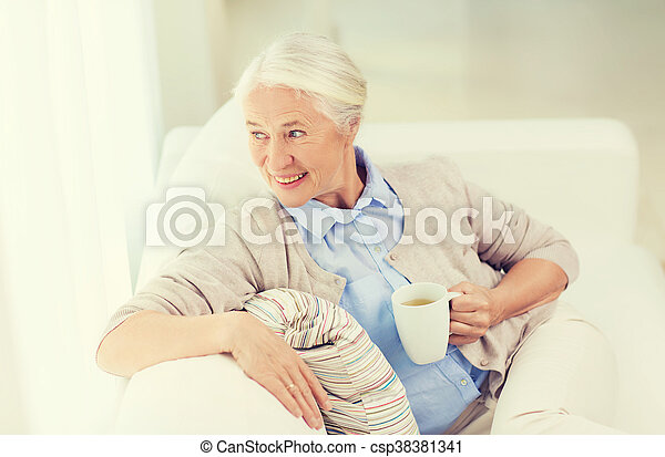 happy senior woman with cup of tea at home - csp38381341