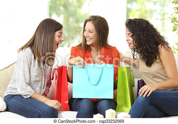 Happy shoppers with shopping bags - csp33232069