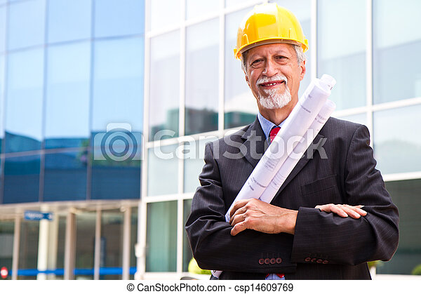 Happy, smiling older architect looking out - csp14609769