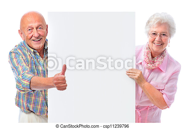 happy smiling senior couple with a blank board - csp11239796