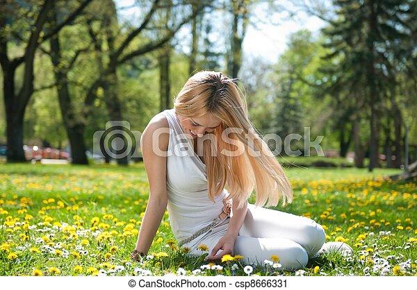 Happy smiling teen girl outdoors - csp8666331