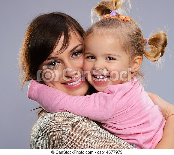 Happy smiling young mother hugs her little daughter - csp14677973