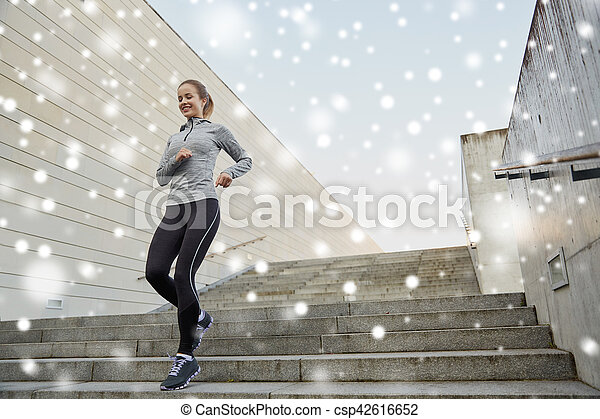 Happy Sporty Woman Running Downstairs In City
