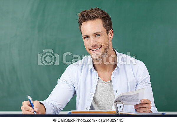 Happy Student In Front Of Chalkboard - csp14389445