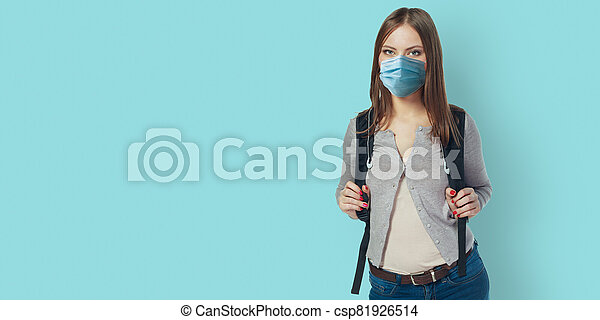 Happy student woman in mask - csp81926514
