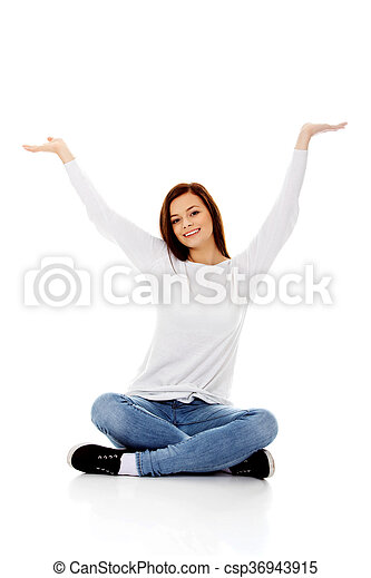 Happy student woman sitting with arms up - csp36943915
