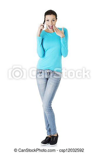 Happy surprised woman with cell phone - csp12032592