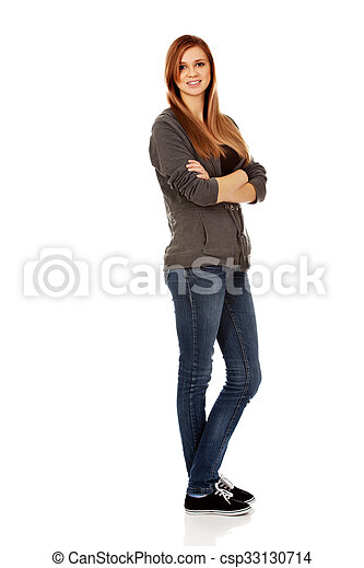 Happy teen woman with folded arms - csp33130714