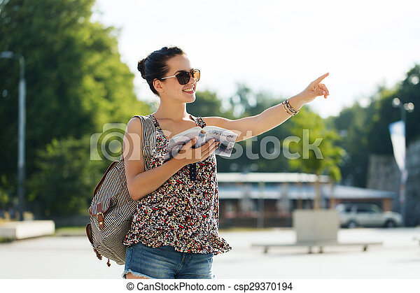 happy teenage girl with guidebook and backpack - csp29370194