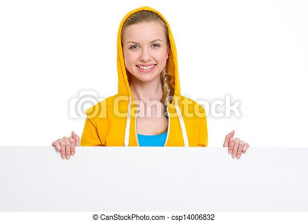Happy teenager girl showing blank billboard - csp14006832