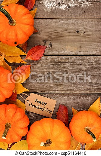 Happy Thanksgiving Tag With Corner Border Of Pumpkins And Leaves Over Wood