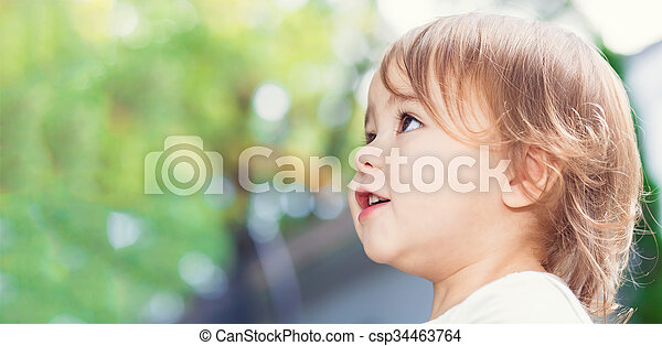 Happy toddler girl close up panorama outside - csp34463764