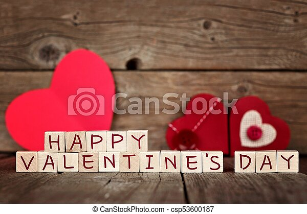 Happy Valentines Day Wooden Blocks With Red Hearts Against A Rustic Wood Background